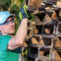 man uses safe wood pallets for home DIY