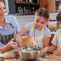 two kids are baking learning life skills teaches by mother