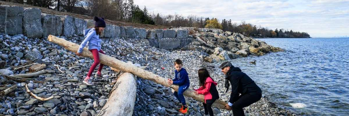 three happy kids and their father in river bank-raising kids in a digital world