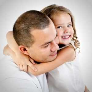 father and child embrace each other during visit after divorce