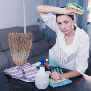 mother holding cleaning materials