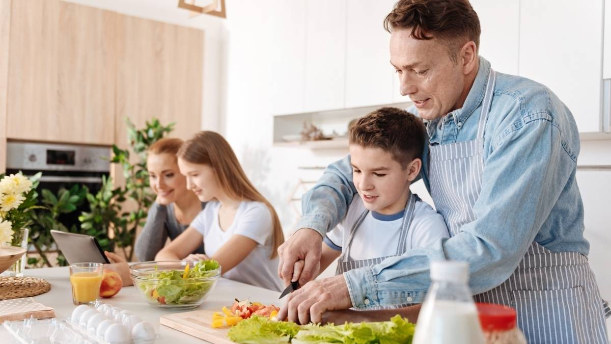 parents on the kitchen teach life skills to kids prepare food