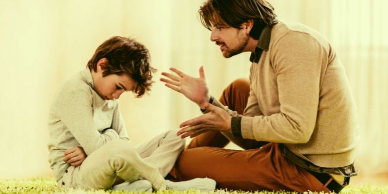 a father and child sitting sharing feelings