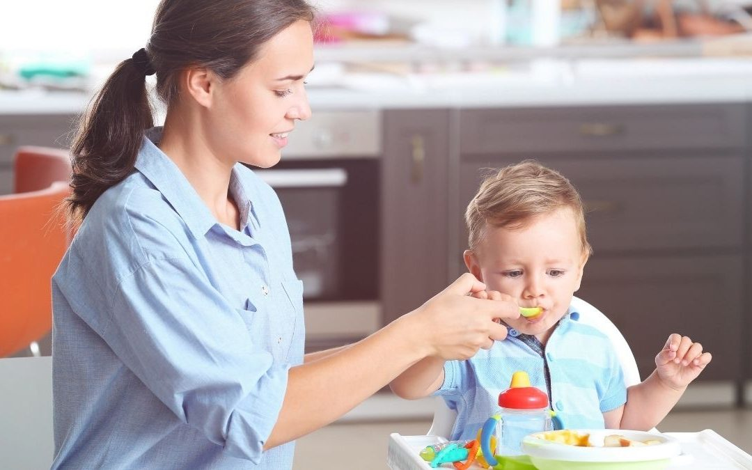 a woman feeding her toddler