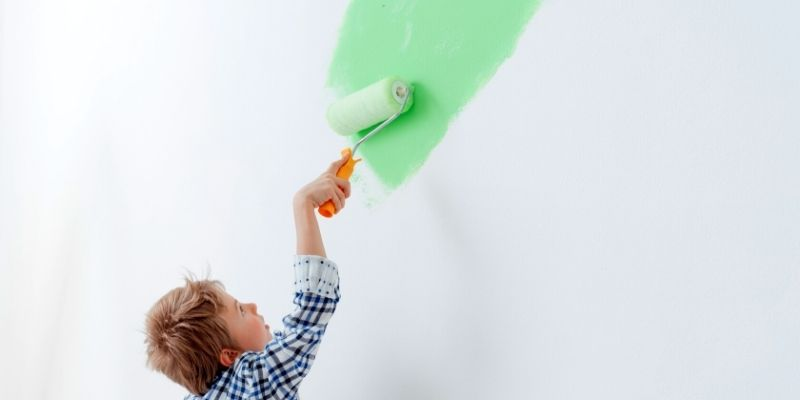 gets kids involved with painting house